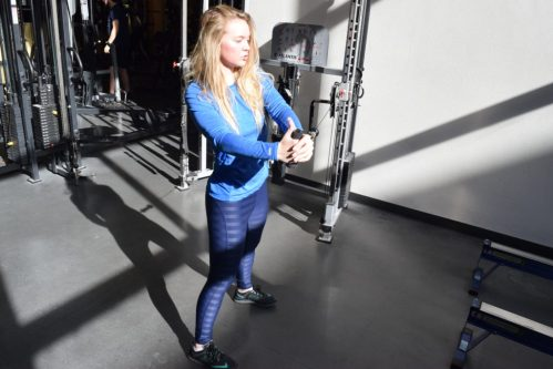 Junior environmental science major Andie White, works out at the Student Recreation Center while wearing athletic clothing in her favorite color, blue. | Alexandria Hasenstab