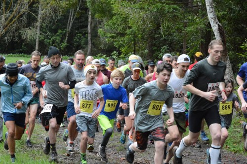 Locals, families, and kids take off at the start of the two mile race in Redwood Park. | Erin Chessin