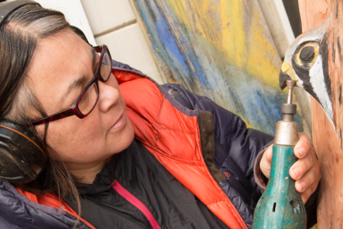 Jessie Groeschen adding some details to her kestrel piece. Photo by | Carlos Olloqui