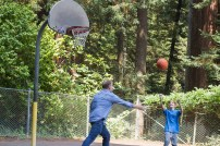 Danny Dickerson and Trace Dickerson playing basketball at Redwood Park.