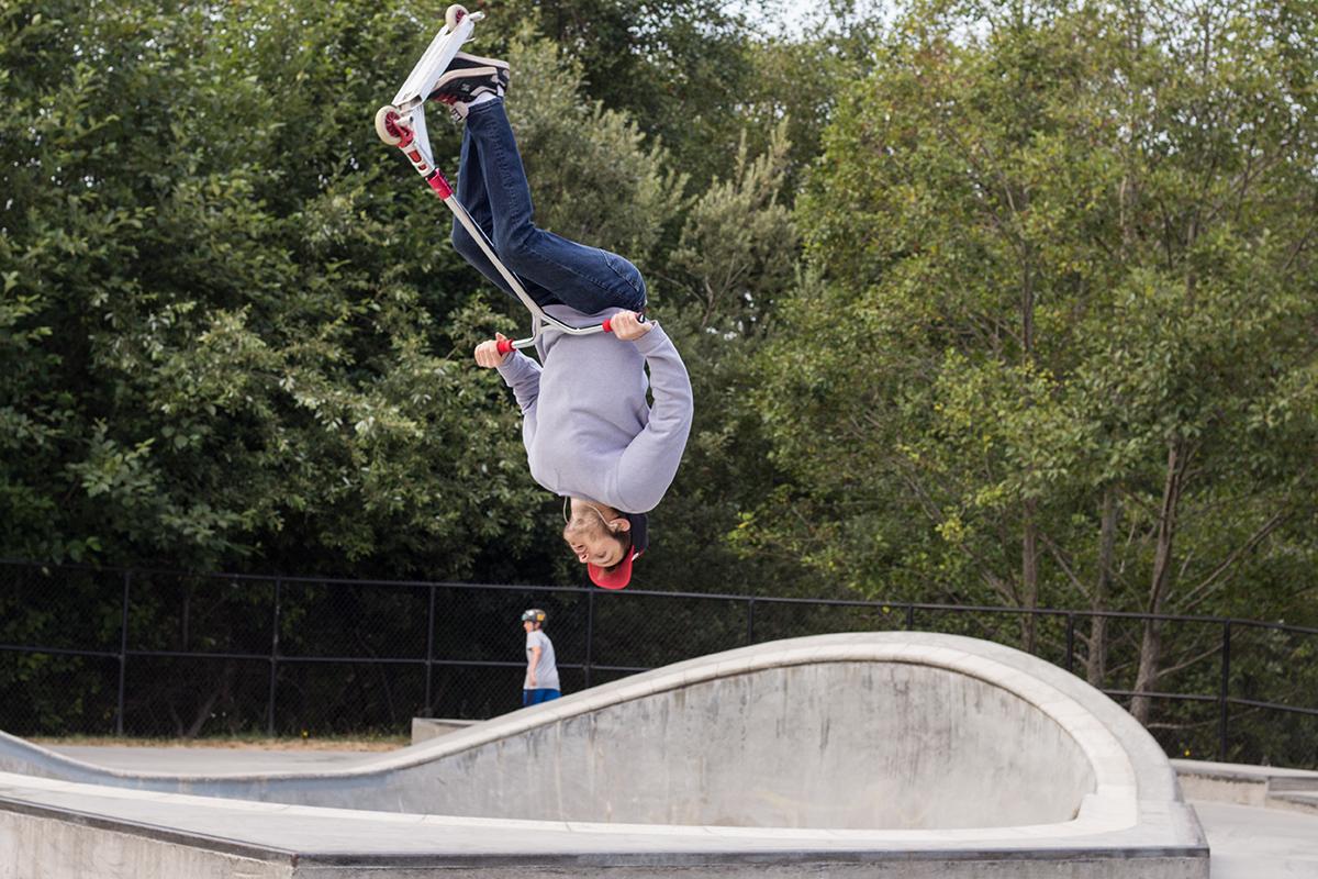 Colin Bonitatibus busts a back flip off the pool at the Arcata Skate Park.