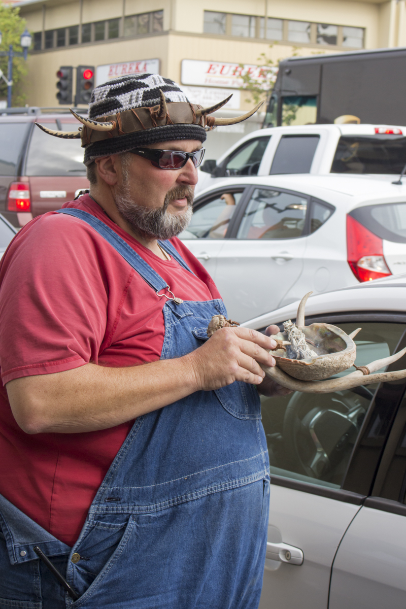 Joe Mckenzie holding antlers and an abalone shell filled with white sage at the protest.   Photo by Ian Thompson