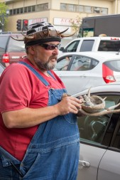 Joe Mckenzie holding antlers and an abalone shell filled with white sage at the protest. | Photo by Ian Thompson