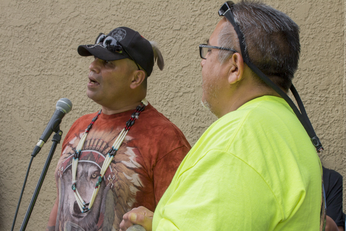 Left to right, Fred Lewis talks to the crowd with Ted Hernandez.   Photo by Ian Thompson