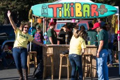 Folks gathered around the Tiki bar at homecoming.