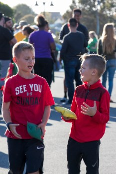 Connor (LEFT), 10, and Luke Jones (RIGHT), 8, argue with eachother while playing cornhole in the SBS Parking Lot during the HSU homecoming tailgate on Oct. 14, 2017.