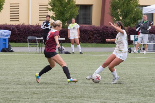 Abbie Jones (left) defending HSU player Erin Seigel (right.) | Photo by Ian Benjamin Finnegan Thompson