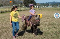 Coastal Grove teacher Katie May and daughter Zara walking with Peetie the pony.