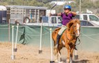 Left handed archer Mandy Smalley shoots off her horse Jasper.