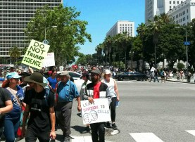 Protestors march down Spring Street in LA   Photo by Kelly Bessem