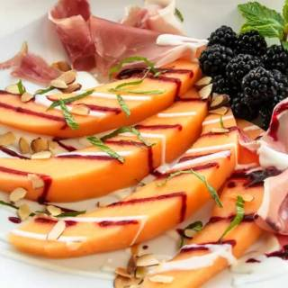Tuscan Melon & Blackberry Salad with Prosciutto & Yogurt Chevre Dressing
