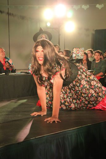 Drag queen Uli on hands and knees being sassy for the camera. Photo by Jessenya Guerra.
