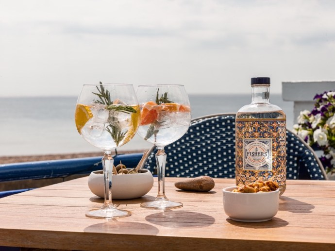 Enjoy Fishers Gin & tonic on the seafront terrace at the Brudenell Hotel, Aldeburgh (med)