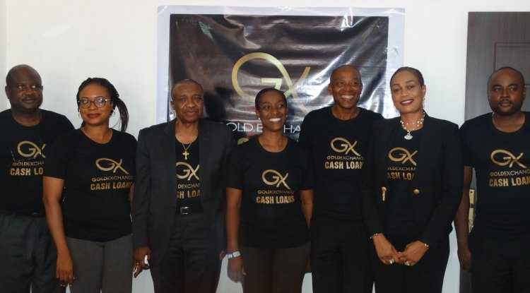 Assistant General Manager, Gold Exchange Limited, Mr. Bosun Awaye (left), Hon. Niyi Oyemade (third from left), Managing Director, Mr. Victor Okezie (third from right), the Chief Executive Officer and Managing Director, Sam & Sarah, Mrs. Folake Oyemade and other members of staff of Gold Exchange Limited, a pawn brokering company, at a press conference unveiling the company at its Victoria Island Office on Monday.