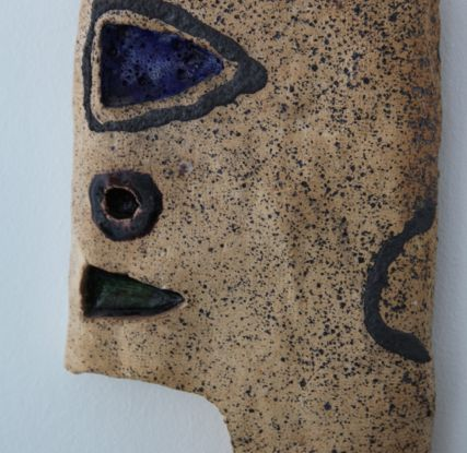 El Anatsui_Bomboy_1979_Manganese, clay and glass_31 x 24 cm