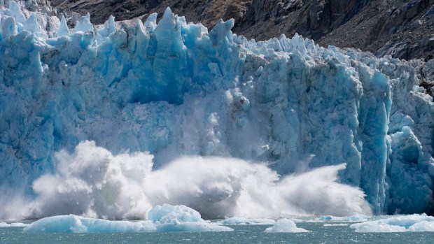 WATCH A TIDEWATER GLACIER CRASH INTO THE OCEAN
