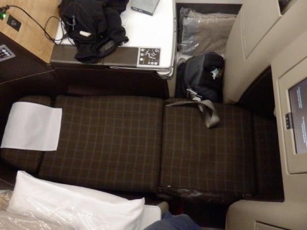 SEAT 8A: LIE FLAT POSITION