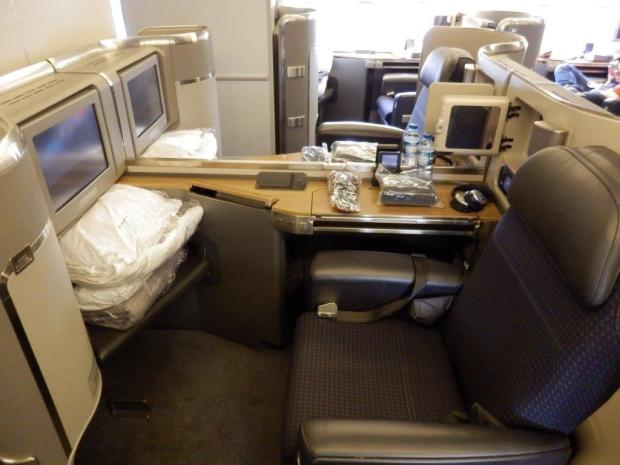 FIRST CLASS MIDDLE SEAT