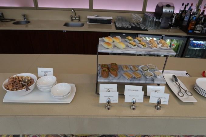 EMIRATES FIRST CLASS LOUNGE AT DUBAI: MAIN SEATING AREA (FOOD STATION)