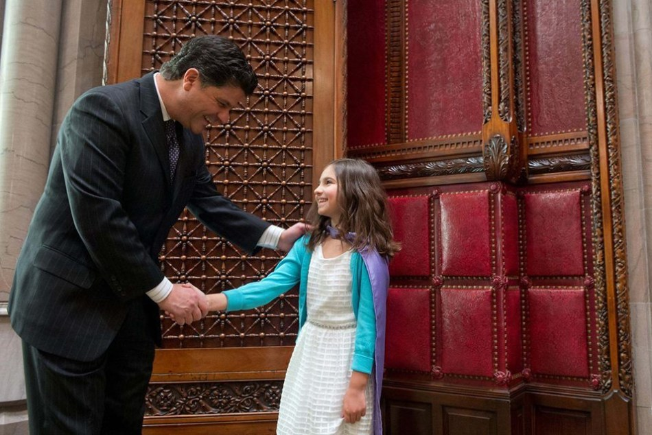 Emma shaking hands with New York State Senator George A. Amedore, Jr.