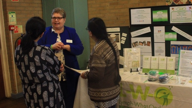Gaynor Leech at an L-W-O informational table during a Cancer Awareness and Support Event in Coventry.