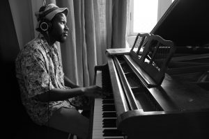 Issac Eady performs on piano
