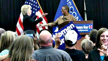 Hillary Clinton greets Martha Love, Milwaukee activist and community organizer. Love introduced Clinton. (Photo by Eelisa Jones)