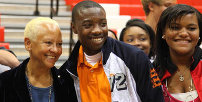 Poet, activist, and HistoryMaker Nikki Giovanni poses with student at Back to School Day.
