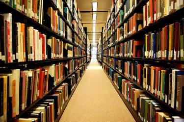 books-shelves-aisle-rows-library