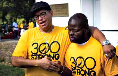 "Two men bond during Saturday's ""300 Strong"" event, the first gathering of what is now the Black Male Collaborative. Photo courtesy of Universal Companies."
