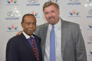 Dave Zuchowski, President & CEO of the Hyundai Corporation shares a moment with NNPA National Sales Representative Steven Larkin, during the Congressional Black Caucus, at Hyundai's kick off event for their foundation's fight to eradicate childhood cancer.