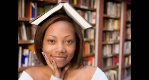 student-color-education-america-woman-book-over-head