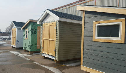 Sheds that students built to gain hand-on experience and develop their tool use. See bottom of article for details regarding purchase of sheds.