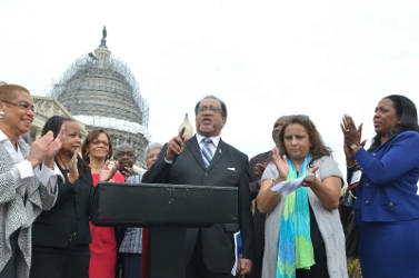 NNPA President Benjamin Chavis speaks outside of the U.S. Capitol during a joint press conference between NNPA and NAHP. The press conference was attended by Washington, D.C. Congresswoman Eleanor Holmes Norton (far left). (Freddie Allen/AMG/NNPA)