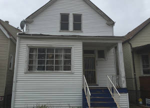 Time and neglect have beset Payne's childhood home as crime and shootings continue to force residents to leave the neighborhood.