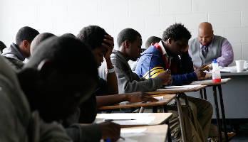 teacher-wstudents-desks-classroom