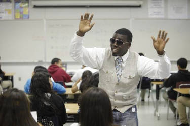 Algebra teacher LaMar Queen wears his rap glasses as he sings along to his Algebra students at the Los Angeles Academy in Los Angeles. The Los Angeles Unified School District teacher has won two awards for his innovative teaching method, by creating rap songs out of math concepts. Damian Dovargan/AP Photo
