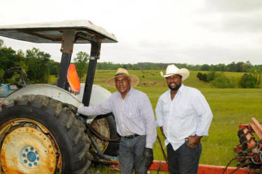 John Wesley Boyd, Sr. (left) and John Wesley Boyd, Jr., president of the National Black Farmers Association. Photo courtesy: Fred Watkins.