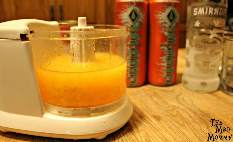 Making a vodka cocktail with mandarin oranges and Liquid Ice Orange Energy Drink.