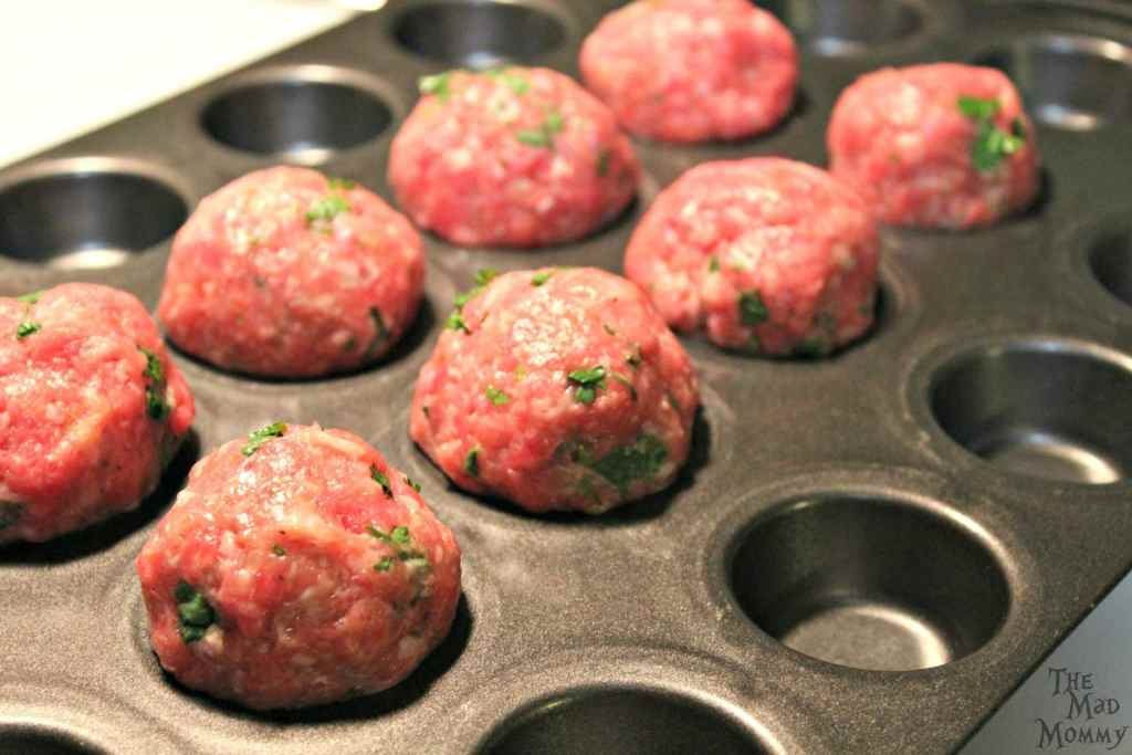 I like to bake my meatballs in a mini-muffin tin. I feel like it cooks them evenly, helps them hold their shape and also, the muffin cups catch all of that excess grease and fat that we don't really need.