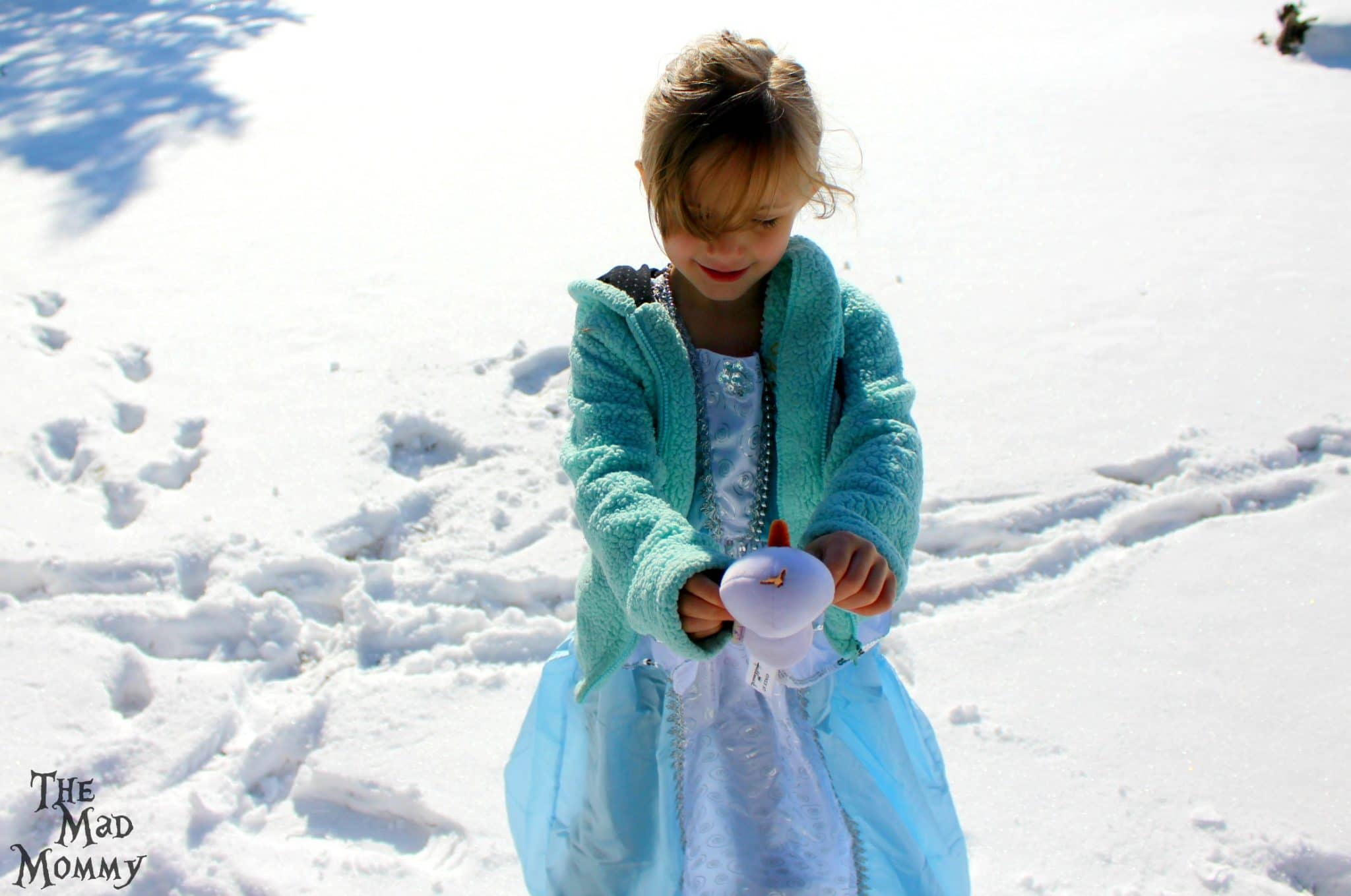 Dancing with Olaf in her washable and wearable Little Adventures Cinderella inspired dress.