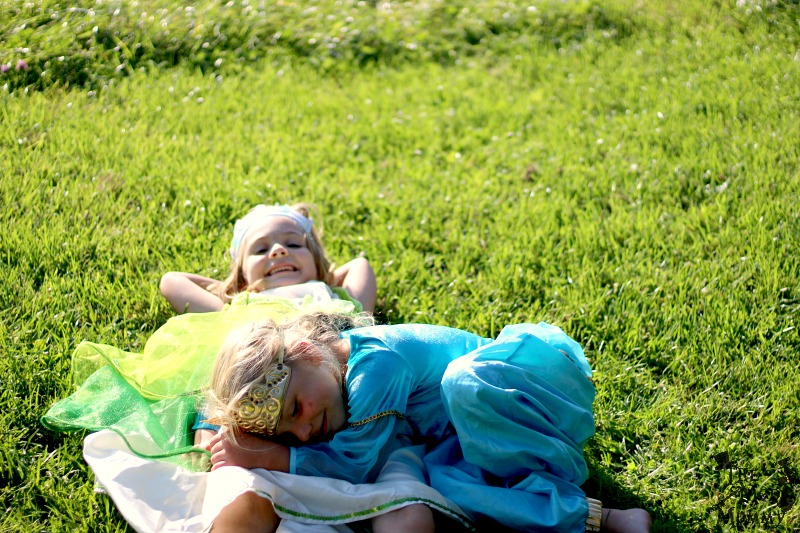 Laying in the grass in outfits from The Whimsy Factory!