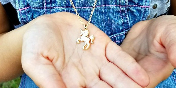 And A Golden Unicorn Around Her Neck!