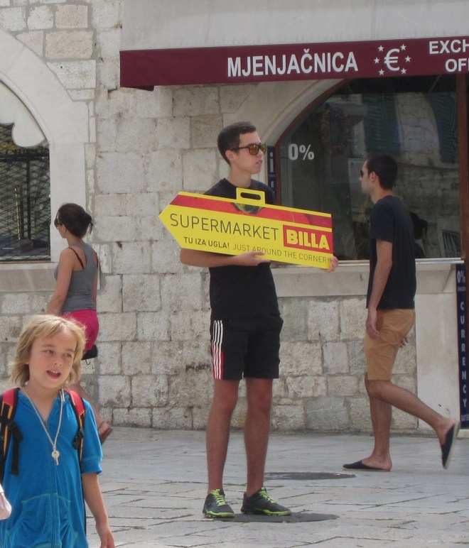and finally, could this be the worse job in Split? The man is a human signpost for the nearby supermarket