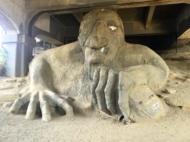 Trolls come from Scandinavian folklore. They are ugly beings with big noses and long arms. They live in the dark away from sunlight; in caves or under bridges are likely places to find them. The Fremont troll lives under the George Washington bridge. They are attracted to shiny things (the Fremont troll holds a VW in his hand); children and 'luminous women' are at particular peril when there is a troll around.