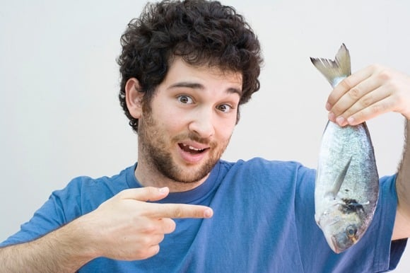 Man Holding a Whole Fish