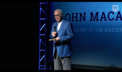 John MacArthur image speaking at conference on self importance and making a difference