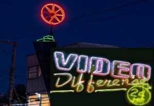 Local pizzerias engage in bidding war for Video Difference's inexplicably pizza-shaped neon sign