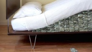 Taxes paid by rich down, mattresses stuffed with cash way up