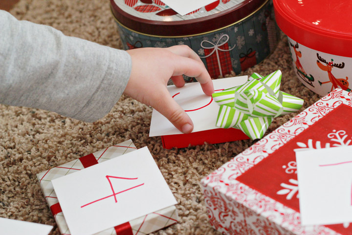 Kids excited for Christmas? This simple Christmas preschool learning game is a great way to use something kids love--opening presents at Christmas--to teach them valuable academic skills.